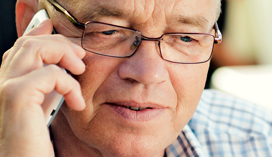 Mature adult man on the phone looking concerned